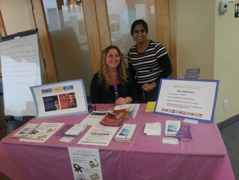 Our therapist and medical secretary at the Hub displaying our services at an event.