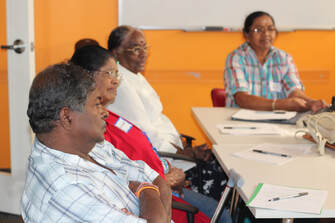 Tamil Seniors are reflecting on the topics discussed in a group setting.